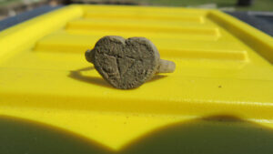 An intact heart-shaped ring was found during the beginning of the 2020 archaeological season at Colonial Michilimackinac.