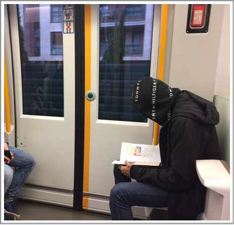 Text Box: Students studying on public transport