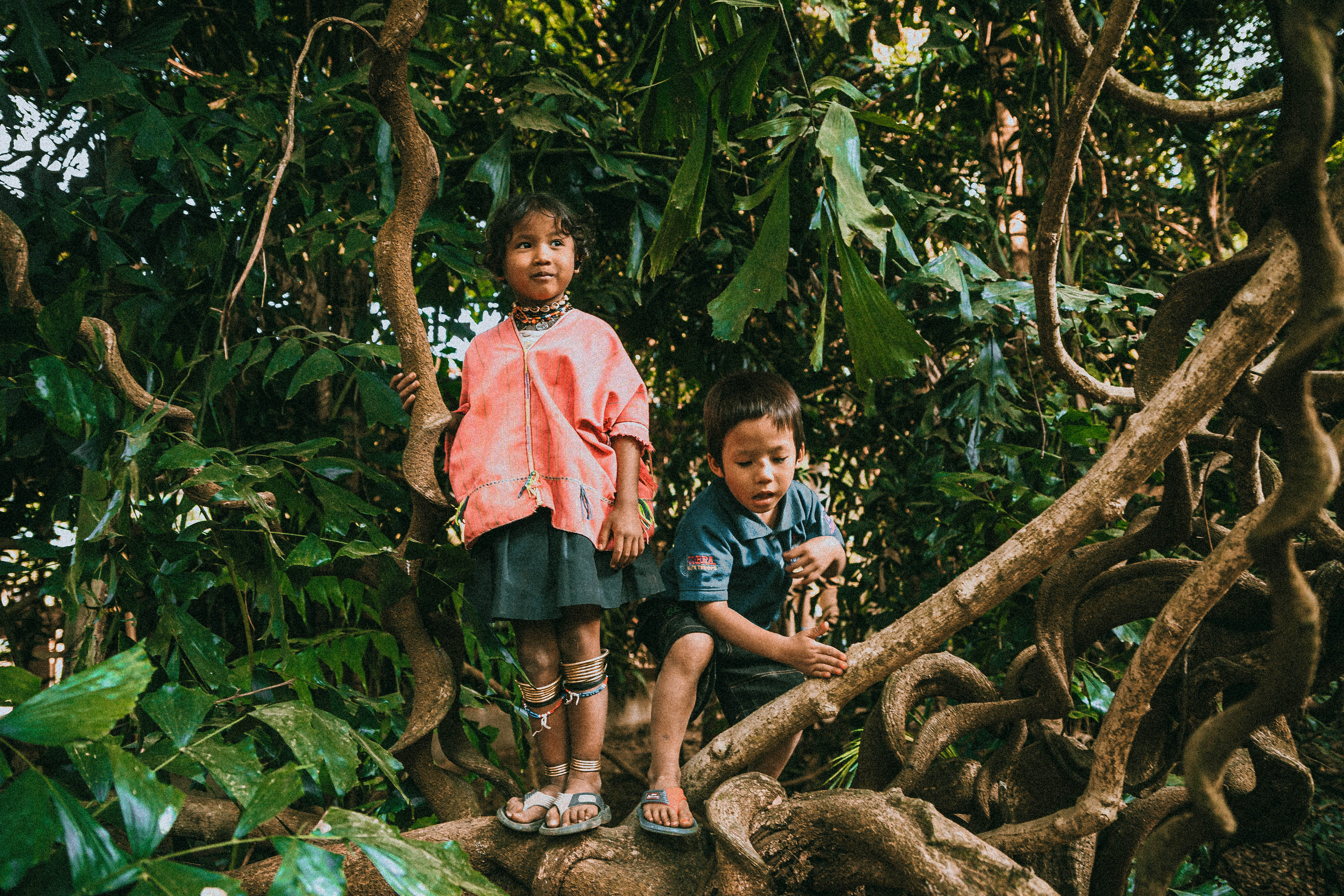 LOCAL KIDS POSING IN THE JUNGLE IN THAILAND