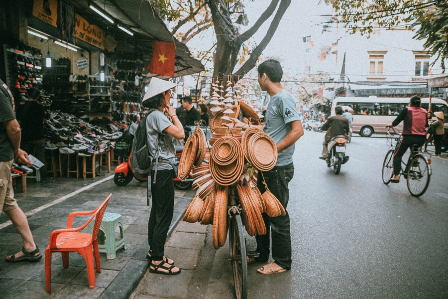 Locals in Hanoi selling all kinds of goods and the traditional vietnamese hats but most importantly dont forget to bargain for the price