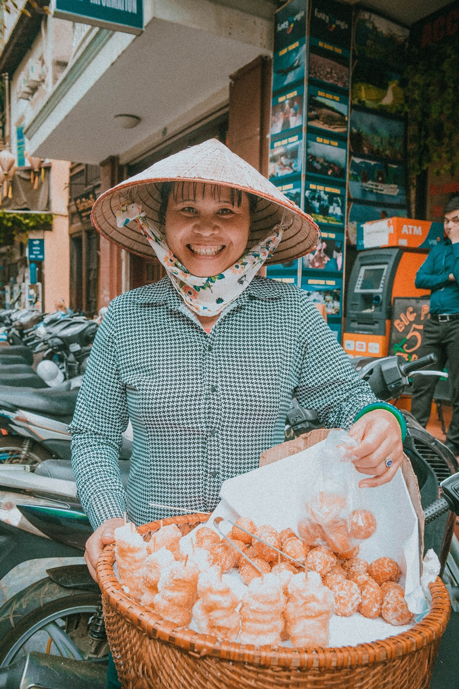 local vietnamese lady selling donuts known as Banh Tieu in Hanoi vietnam