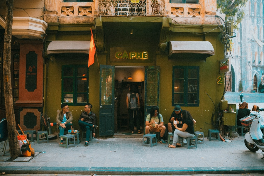 one of the many vintagee coffee shops in hanoi vietnam with an outdoor seating and lovely french feel to it