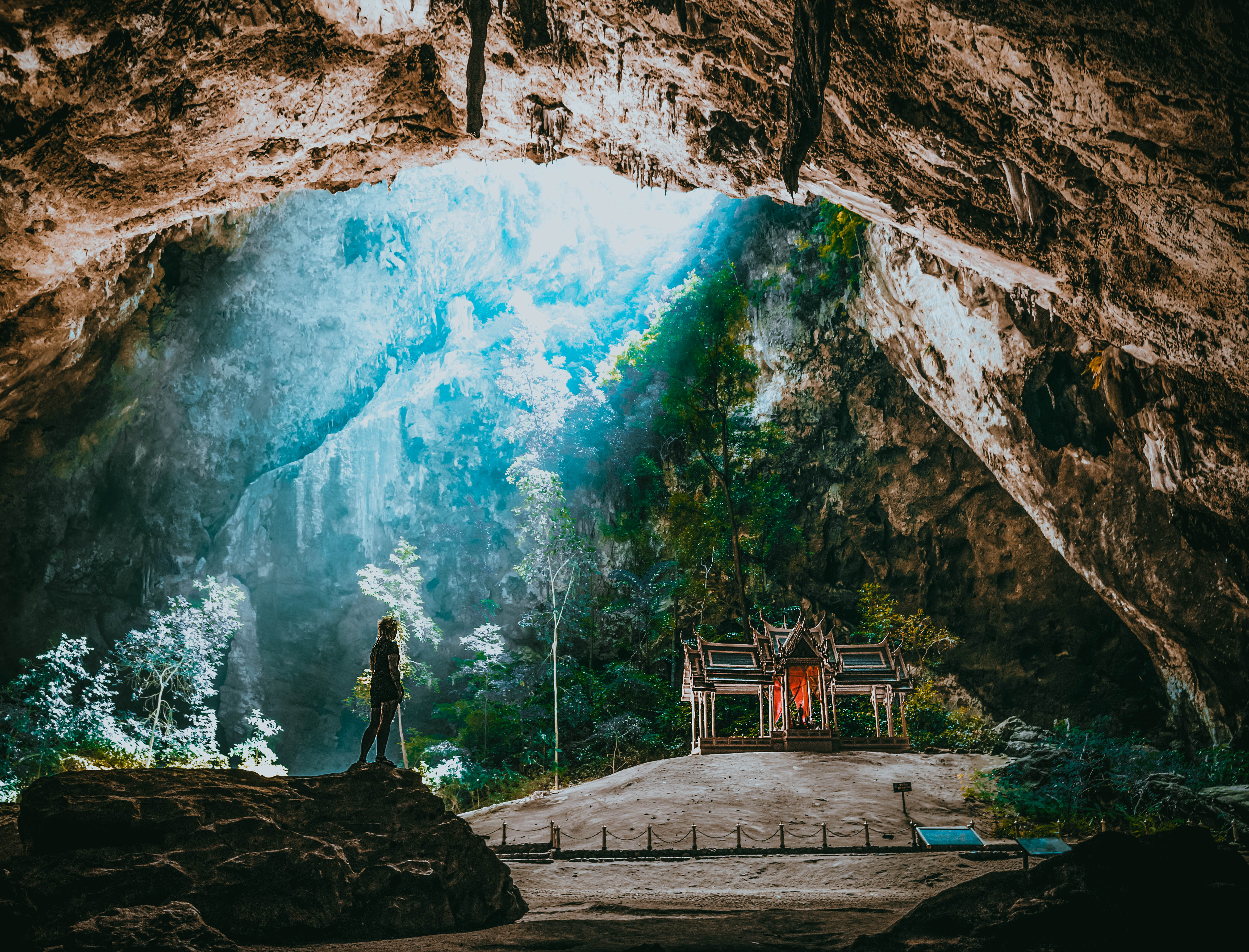 cave with a temple inside buddhist thailand