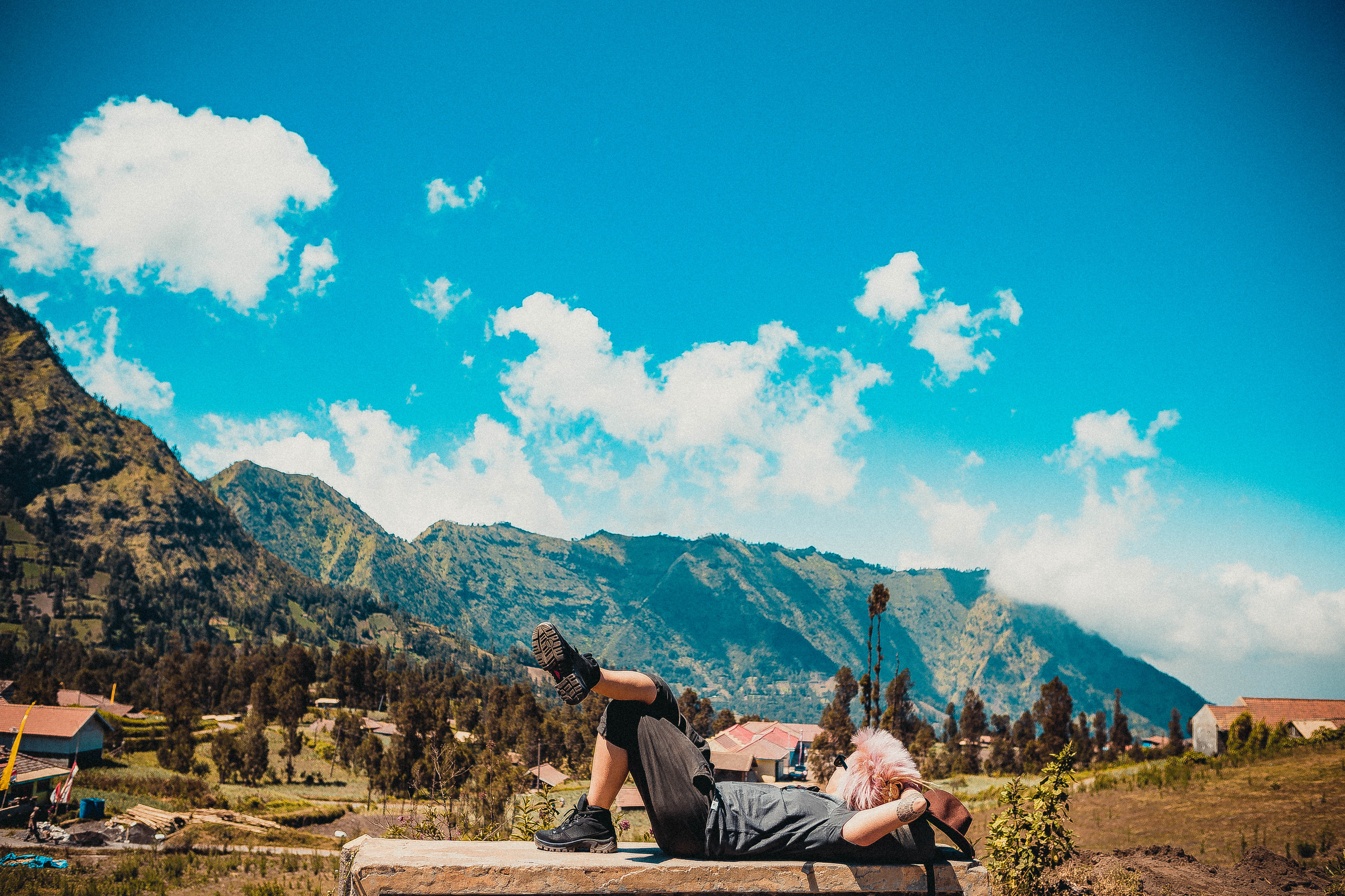 chilling next to the hike Mount Bromo mountains around greenery sunny day