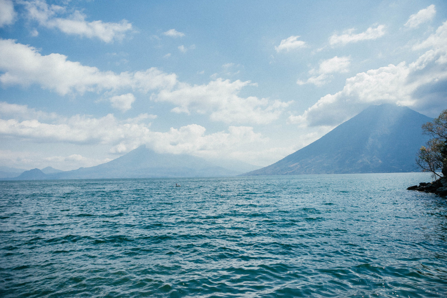 guatemala lake atitlan lago central america most beautiful lake in the world volcanoes sky on fire sunset blue