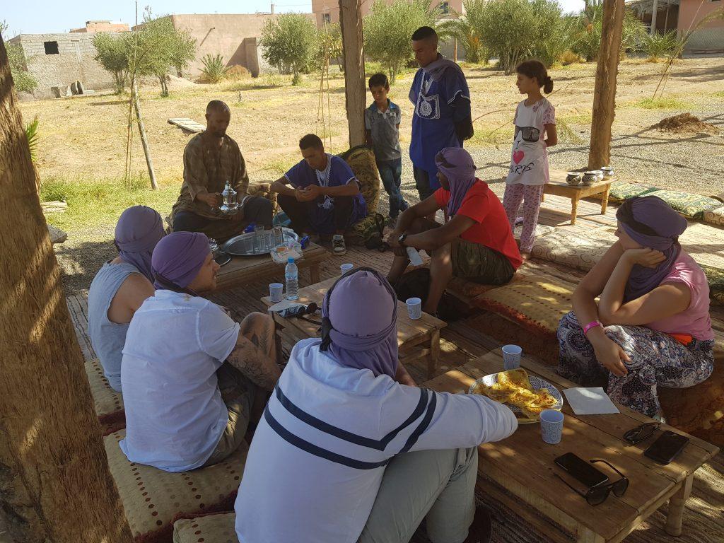 Berber man serves mint tea in Marrakech
