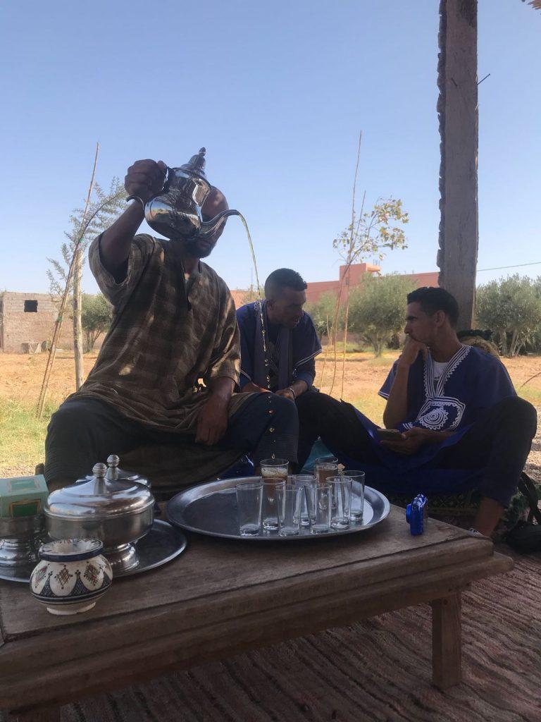 our host entertains us as he serves Morrocan mint tea