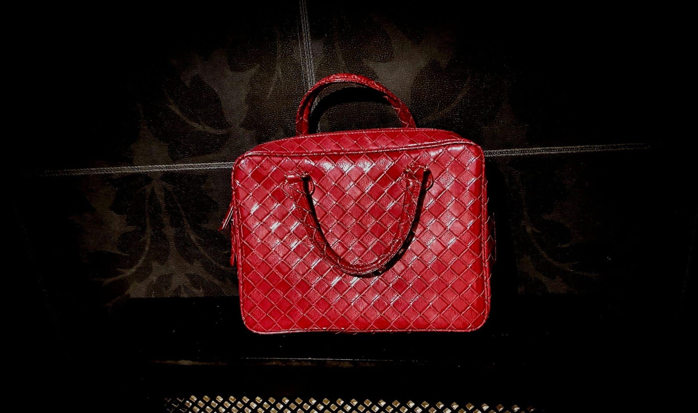 Red Estee Lauder train bag