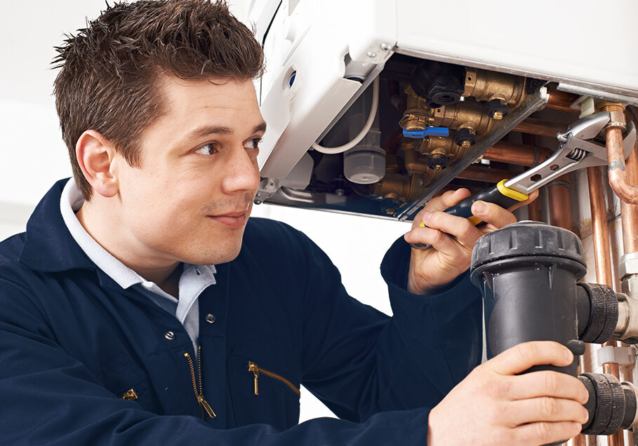 Male,Plumber,Working,On,Central,Heating,Boiler