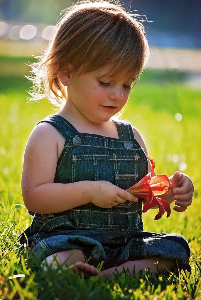 girl, sitting, flower-757441.jpg