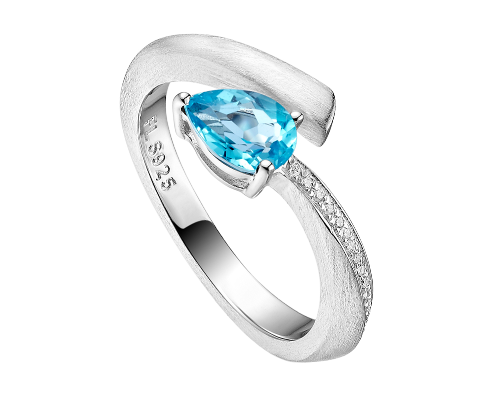 Shooting Star open ring with blue topaz and CZ, set in silver rhodium plate.