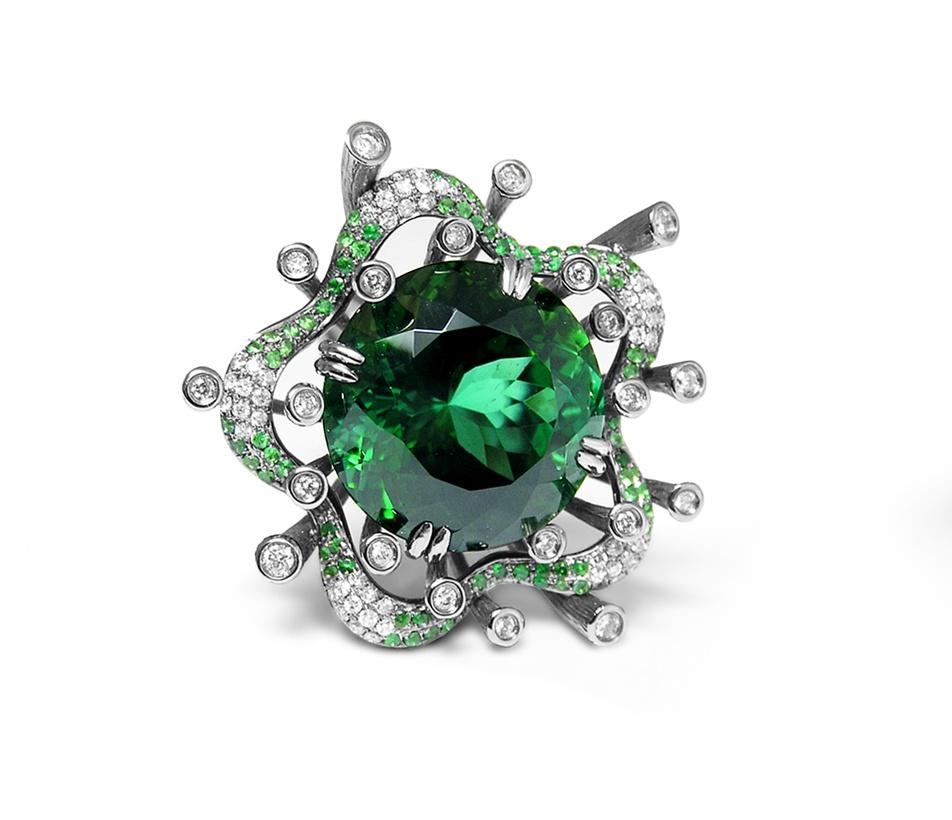 Fei Liu's bespoke Tourmaline Starburst Ring with green garnets and diamonds, in 18ct white gold.