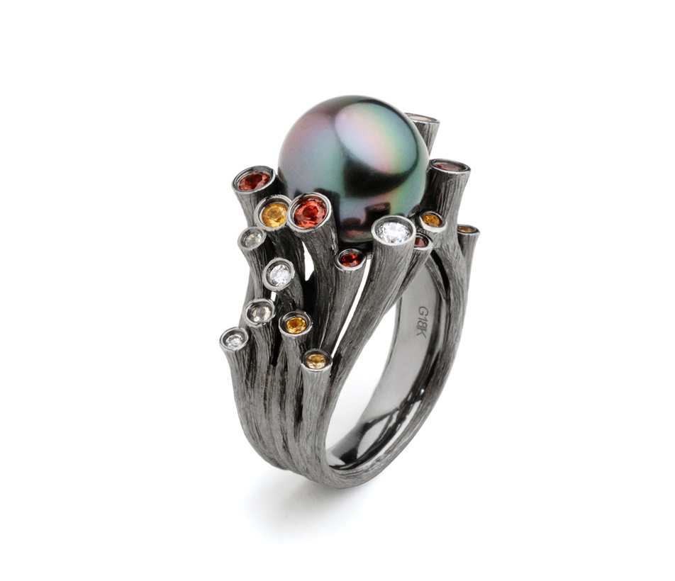 Fei Liu's Dawn ring in 18ct black gold with citrine, mandarin garnets and diamonds. Winner of the Kayman Award.