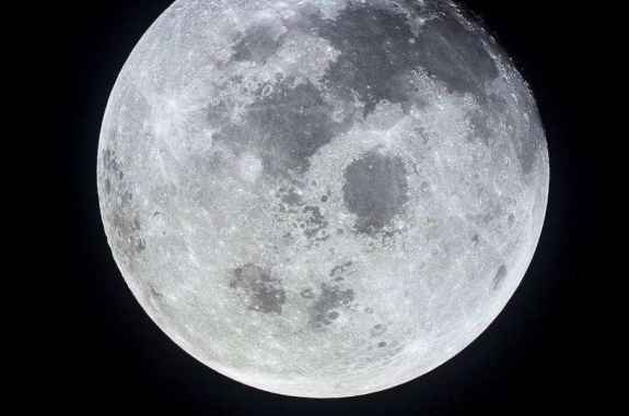 Photo of the full moon, taken from Apollo 11 on its way home to Earth