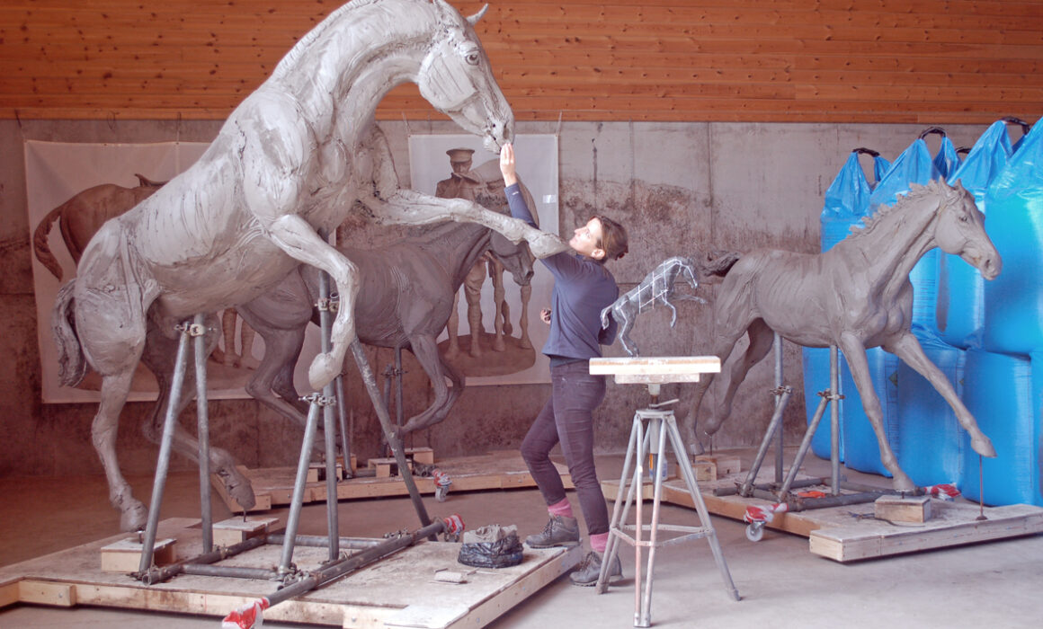 amy goodman working on clay horses