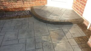Platinum Grey Grand Ashlar Printed Concrete Driveway with Acid-Stained Borders