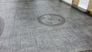 Platinum Grey Grand Ashlar Printed Concrete Driveway with Etched Borders and Compass Feature