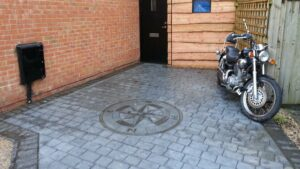 Platinum Grey London Cobble Printed Concrete Driveway with Charcoal Etching and Compass Feature
