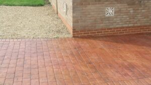Brick Red and Rustic Sandstone London Cobble Printed Concrete Driveway