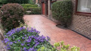Brick Red London Cobble Printed Concrete Driveway with Compass Feature