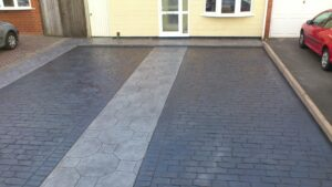 Platinum Octagon Tile and Charcoal Cheshire Cobble Printed Concrete Driveway