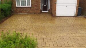 Bideford Buff Riverside Slate and Cobble Feature Printed Concrete Driveway with Mahogany Stained Borders