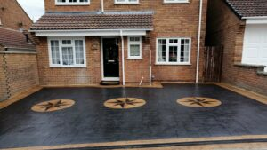 Printed Concrete Driveway in Casesar Stone with Cobble Star Feature