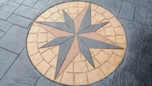 Printed Concrete Cobble Star Feature in Caesar Stone Driveway