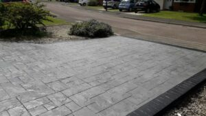 Printed Concrete Driveway by DCS in Platinum Grey Ashlar Slate with Charcoal Release and Black Borders
