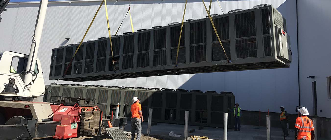 Jackson Services Mechanical HVAC Technicians Installing New System