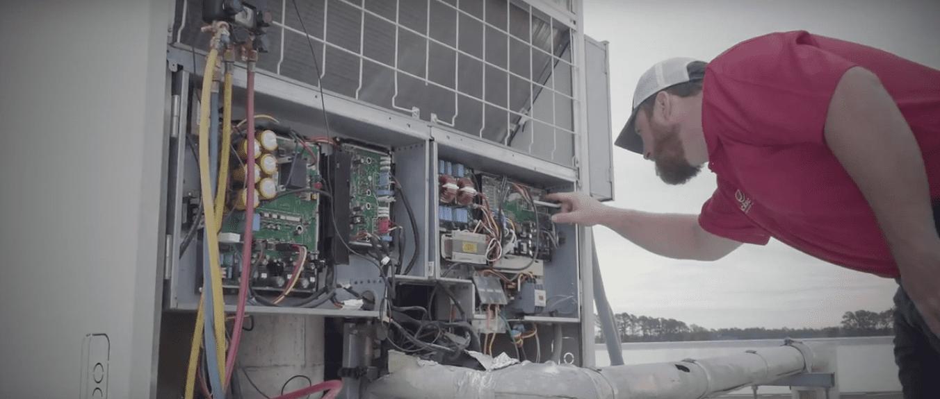 Mechanical HVAC Service Technician Inspecting Unit
