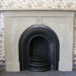Victorian arched cast iron fireplace