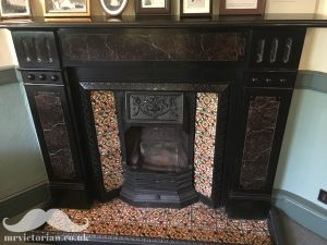 Victorian tile fireplace insert with hearth reinstating a