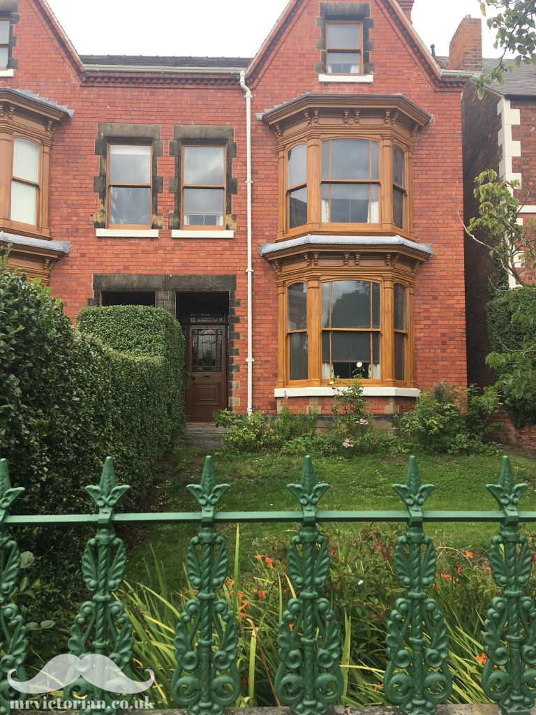 Mr Straw's House showing woodgrained windows and green Edwardian railings