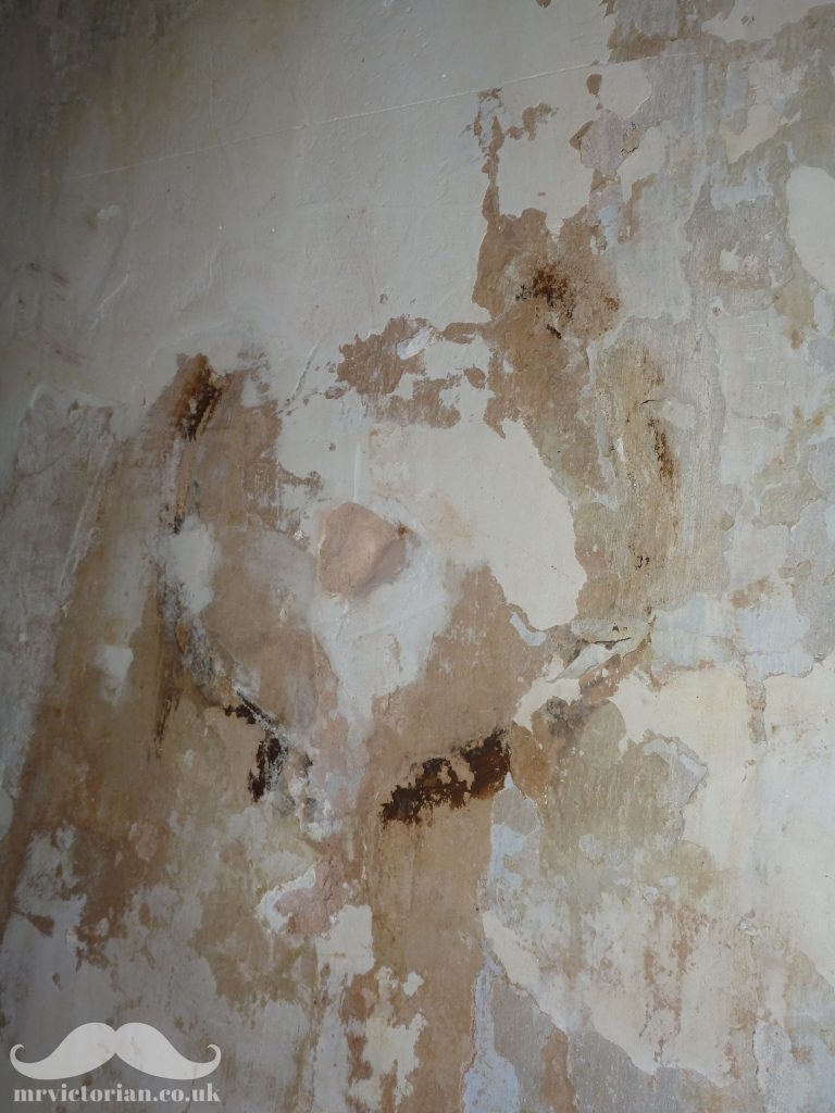 Victorian gas light lamp fitting scar on plastered wall