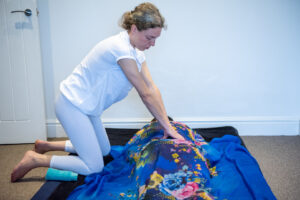 Tatiana Aitken tantric therapist giving tantric massage to female client