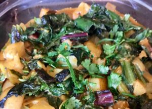 Chard and potato curry ready to serve.