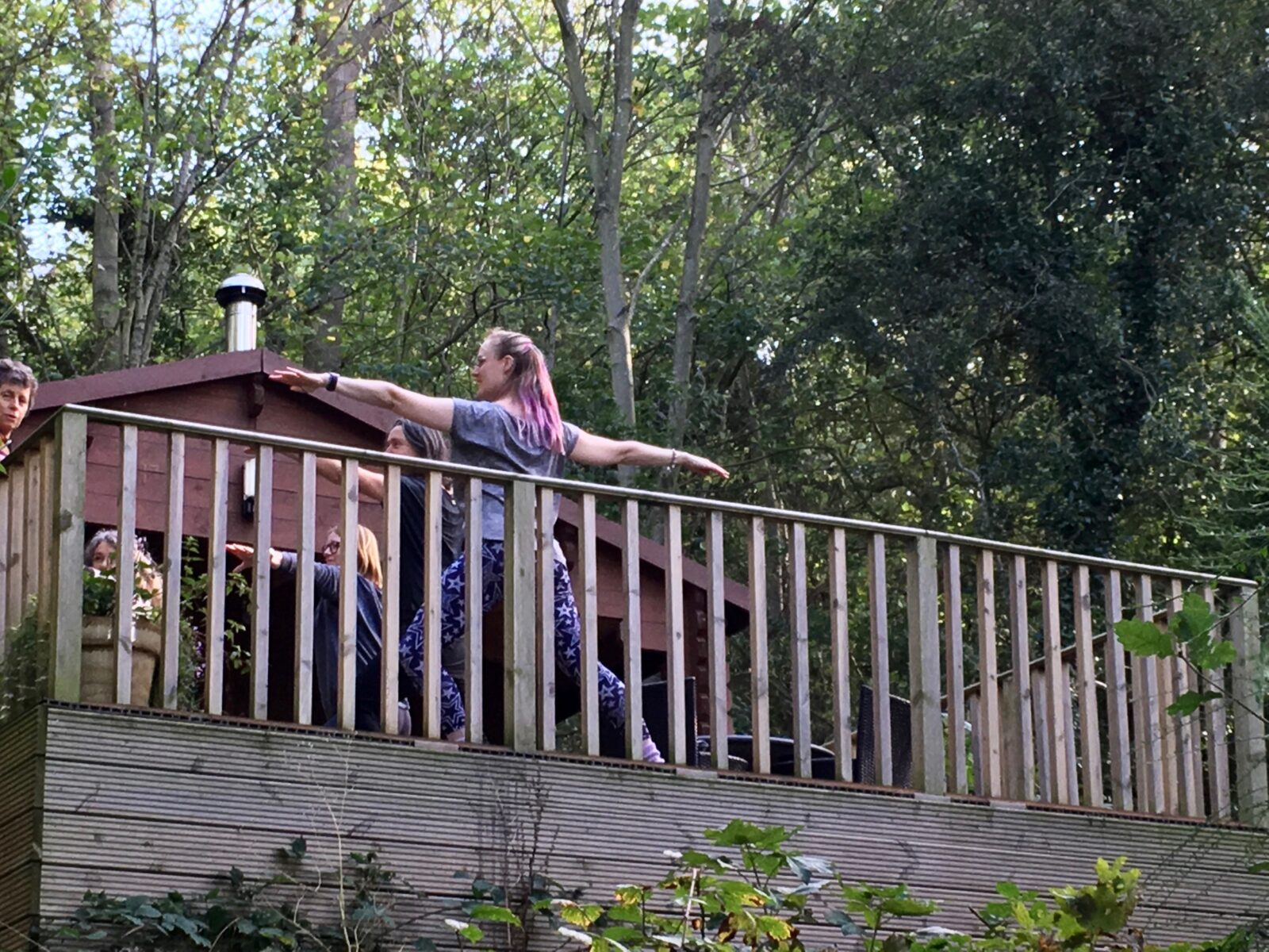 A yoga class on the deck of our log cabin deck in Whitby.