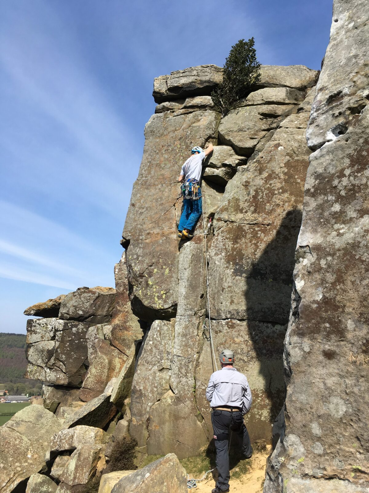 Mark climbing with a partner in the North York Moors.