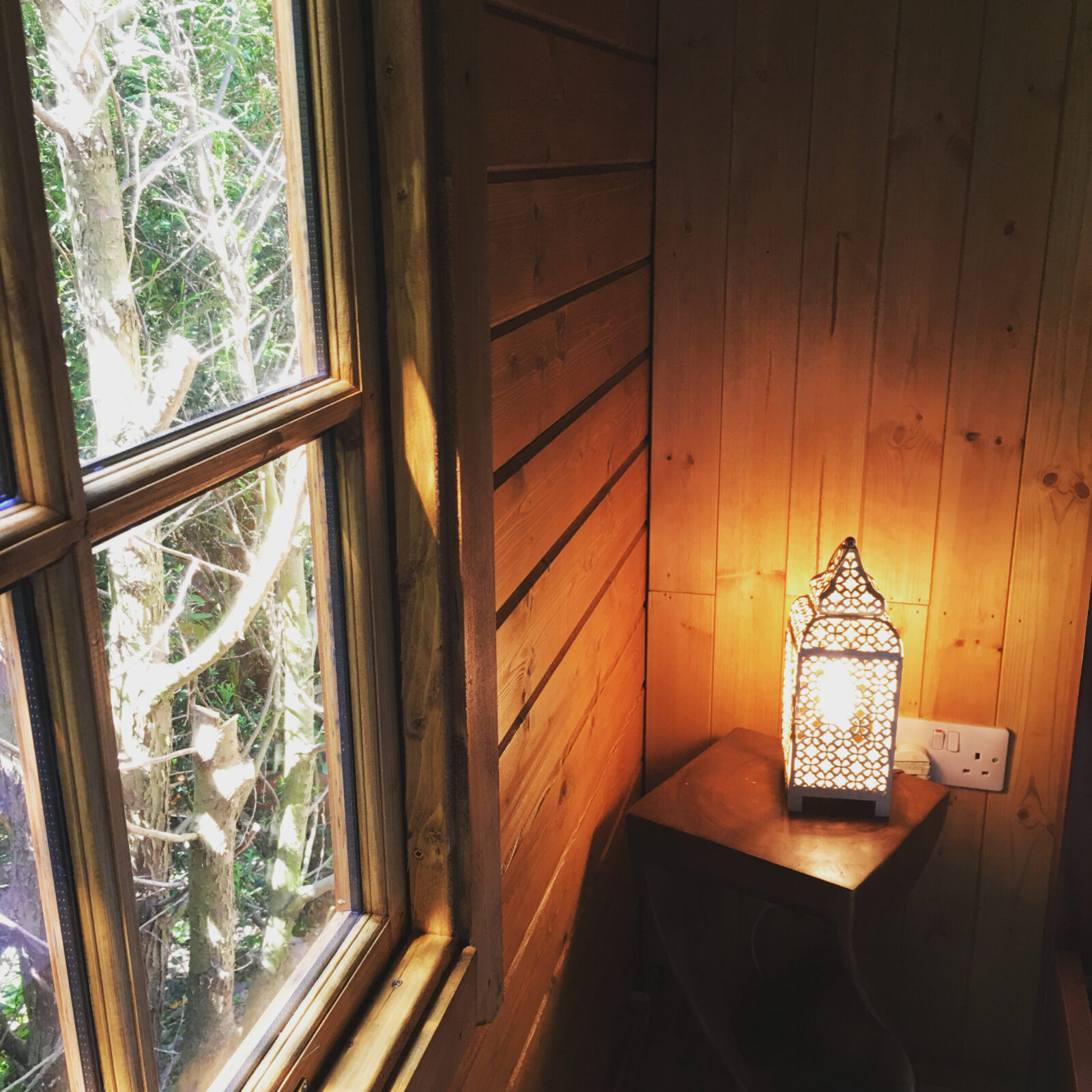 A ornate lamp lit in the corner of one of our cabins.