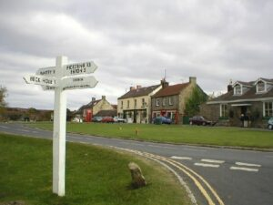 A signpost by a road.