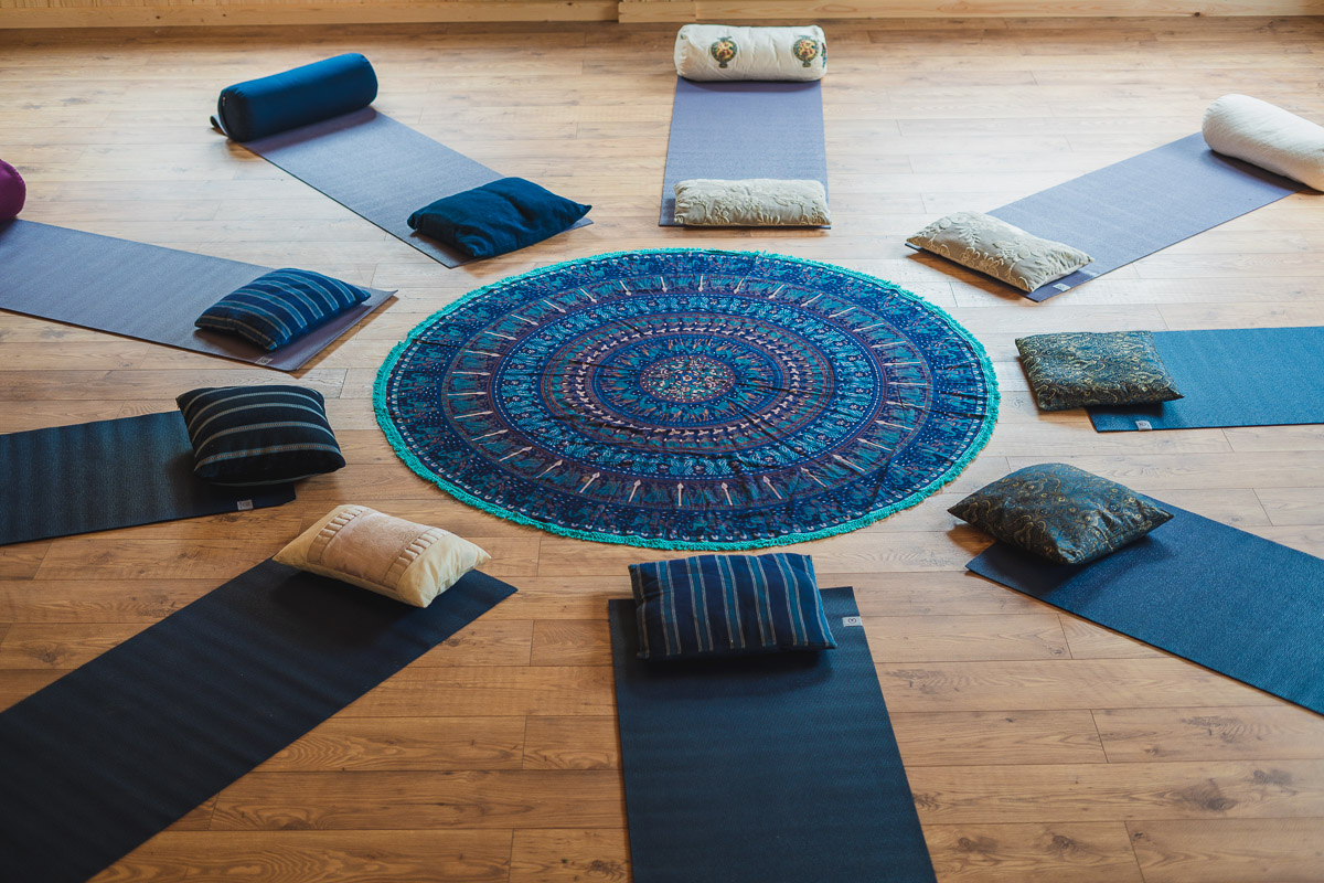 Yoga mats and cushions laid out in a pattern in the Yogandspice Studio.