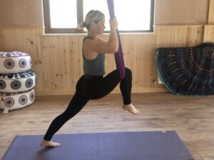 An aerial yoga pose in the Yogandspice Studio.