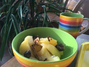 A bowl of spiced fruit and nuts.