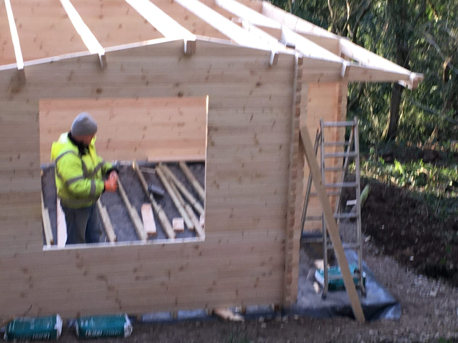 Mark building our log cabin.