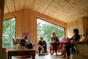 A group relaxing upstairs in the Yogandspice Studio.