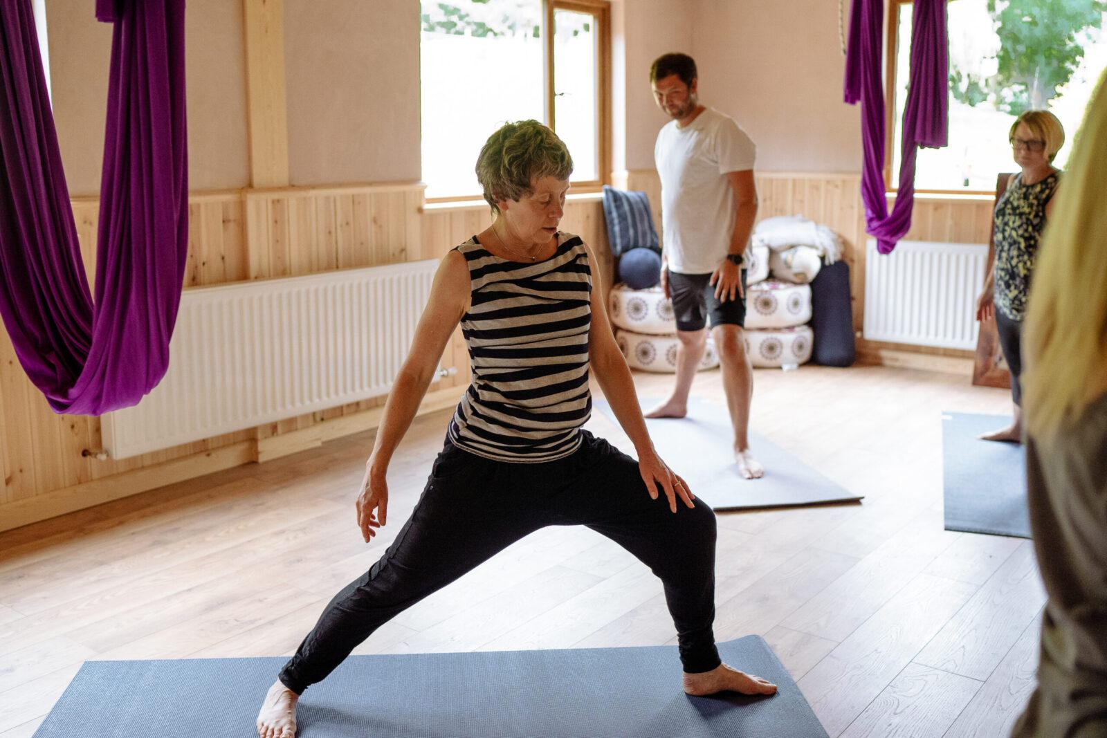 Lorraine leading a yoga class in the Yogandspice Studio.