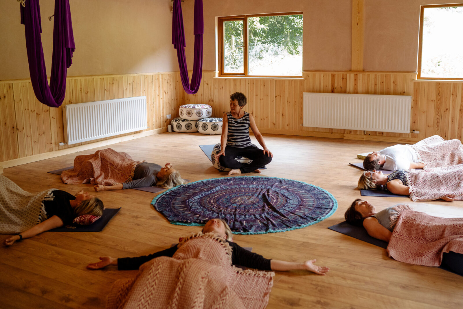 Lorraine leading a yoga class in the Yogandspice Studio, on one of our yoga retreats in North Yorkshire.