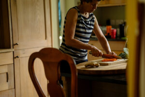 Lorraine preparing a meal in the kitchen for guests on our yoga retreats in North Yorkshire.