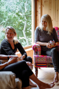 Two women laughing during a wellness consultation.